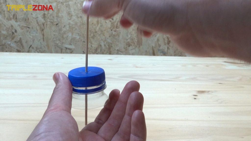 Ajustar perforación a palillo del lanzador