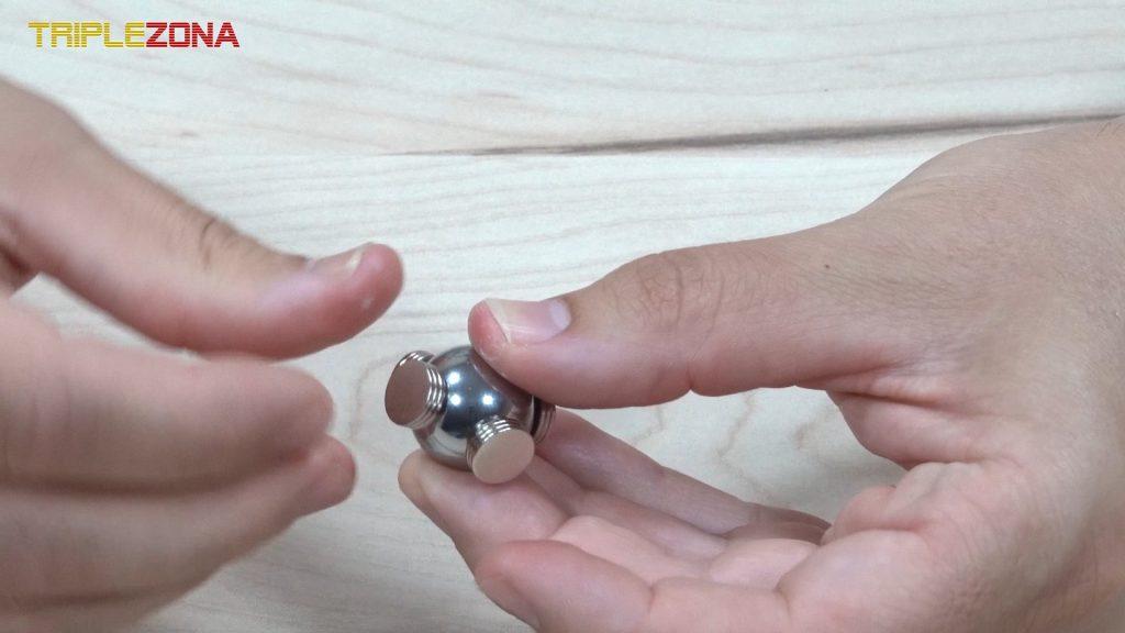 Spinner magnético en cruz