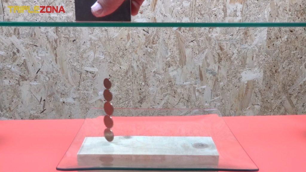 Desplazando monedas levitando con iman