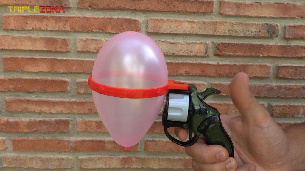 Pistola ruleta rusa con globo